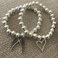 Chunky silver bracelet with charms-2560